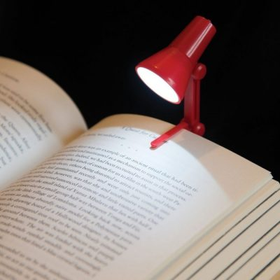 Adjustable Small Reading LED Clip Desk Lamp Light Night Book Reader Travel Mini2 in 1 Adjustable LED Light With Book Clip The 2 in 1 adjustable light is a fantastic modern product that can clip onto books or onto laptops. Book clip included. Supplied in 4 colours Blue or Red or Green or Purple - we will send a random colour. Requires 3 AG3 batteries (included). ON / OFF switch. A battery powered LED mini Desktop Book Lamp. Clip onto your book or stand alone by your laptop